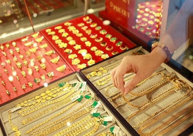 3月12日越南国内黄金价格继续下降20万越盾 hinh anh 1