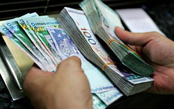 马来西亚新政府考虑调整刺激经济措施 hinh anh 1