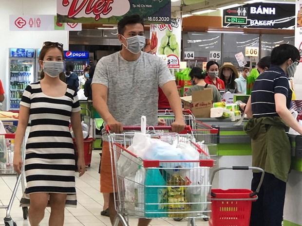 从3月16日起在公共场所必要佩戴口罩新规正式生效 hinh anh 1