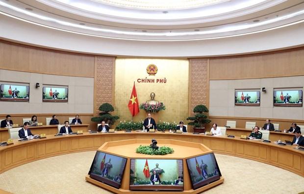 政府总理阮春福:最大限度阻止疫情达到峰值 不让疫情在社区扩大蔓延 hinh anh 1