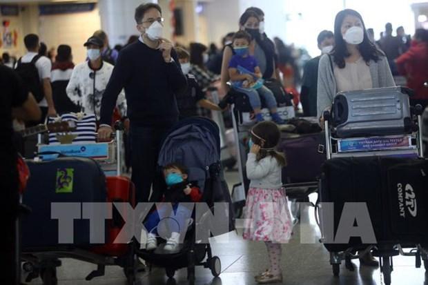 越南外交部提醒越南公民减少不必要出行 hinh anh 1