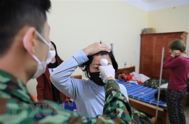 越南第123例确诊病例是一名从马来西亚回来的女性 hinh anh 1