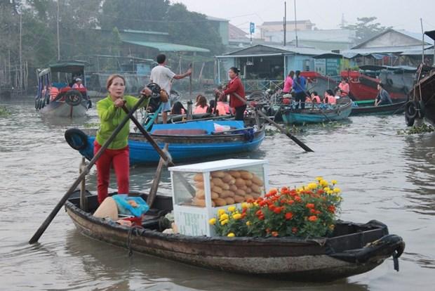 西南部地区水乡特色文化的代表——丐冷水上集市 hinh anh 1