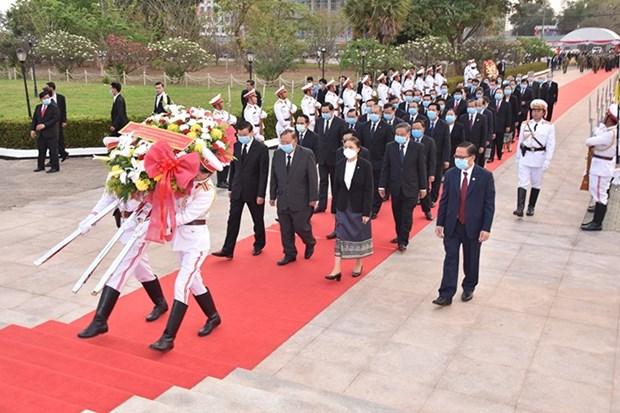 老挝各地纷纷举行老挝人民革命党建党65周年纪念活动 hinh anh 1