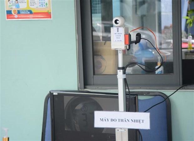 新冠肺炎疫情:越南岘港大学成功研制出廉价的远程体温测量系统 hinh anh 1