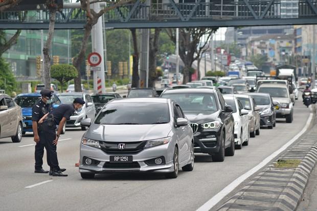 新冠肺炎疫情:泰国-老挝友谊桥临时关闭 马来西亚累计确诊病例1306例 hinh anh 1