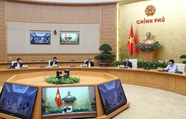 政府总理阮春福要求关闭不必要的服务 减少聚集性活动 hinh anh 1