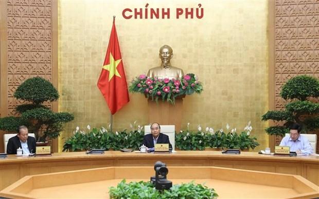 政府总理要求最大限度遏制新冠肺炎疫情在社会中蔓延 hinh anh 1