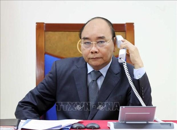 越南政府总理阮春福与老挝总理通伦和柬埔寨首相洪森通电话 hinh anh 1