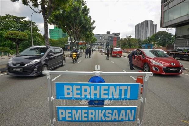 越南驻马来西亚大使馆提醒公民遵守所在国法律 hinh anh 1