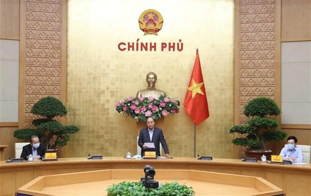 阮春福总理:上下一心、团结一致使疫情防控工作得以更快速、更高效进展 hinh anh 1