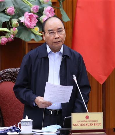 越南政府总理阮春福致信赞扬军队和公安力量在新冠肺炎疫情防控工作中的努力和贡献 hinh anh 1
