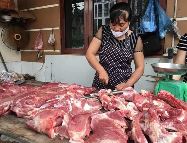越南农业与农村发展部部长阮春强:从4月1日起将生猪价格降到7万越盾每公斤以下 hinh anh 1
