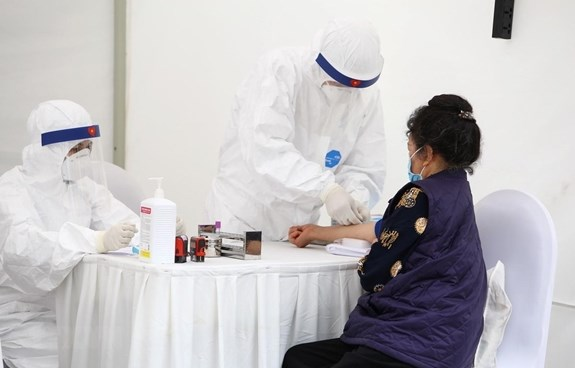 胡志明市基本控制新冠肺炎疫区疫情扩散问题 hinh anh 1
