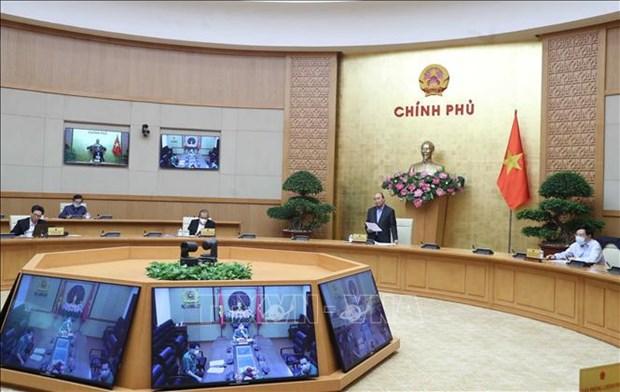 政府总理阮春福:社会增速放缓,但从事防疫工作的人员需提速 hinh anh 1