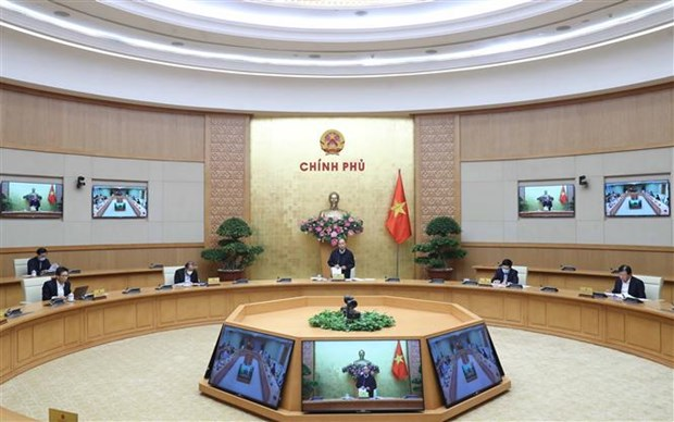 越南政府召开会议 就受新冠肺炎疫情影响的惠民政策措施进行讨论 hinh anh 1