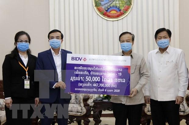 越南企业协助老挝应对新冠肺炎疫情 hinh anh 2