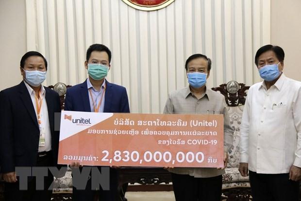 越南企业协助老挝应对新冠肺炎疫情 hinh anh 1