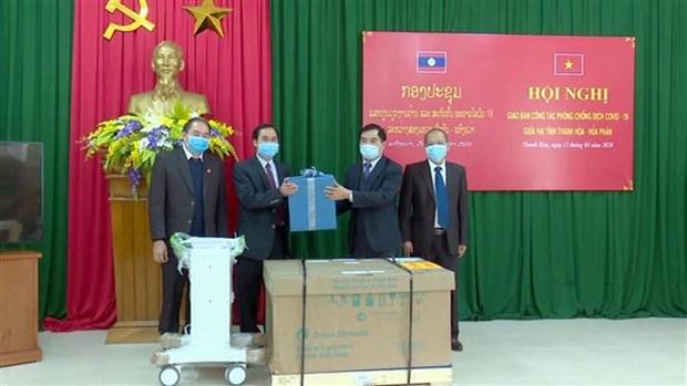 清化省与老挝华潘省互相分享疫情防控经验 hinh anh 2