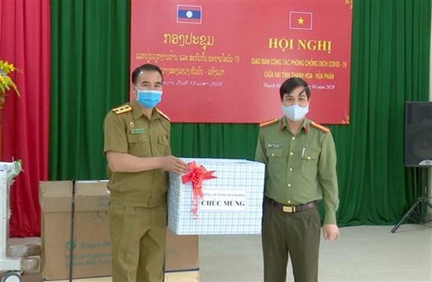 清化省与老挝华潘省互相分享疫情防控经验 hinh anh 3