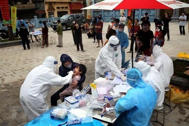 新冠肺炎疫情:对麋泠县夏雷乡居民采集1.1万多份样品进行检测 hinh anh 1