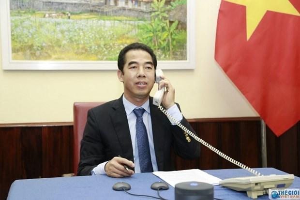 越南外交部副部长与英国务卿通电话 hinh anh 1