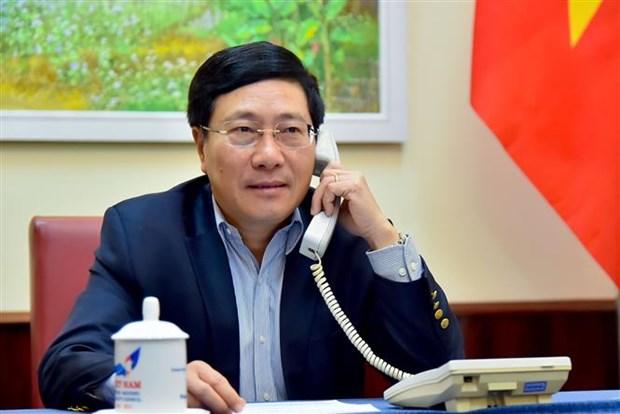 越南政府副总理兼外长范平明与澳大利亚外长通电话 hinh anh 1