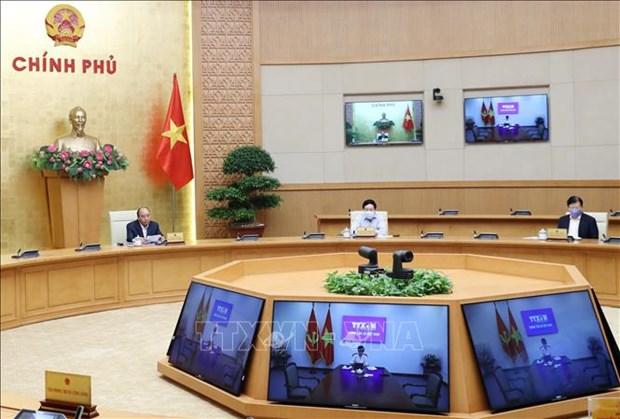 越南政府总理:放松限制性社交活动但仍要采取适当的控制措施 hinh anh 1