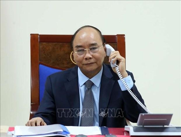 越南政府总理阮春福与俄罗斯总理米舒斯京通电话 hinh anh 1