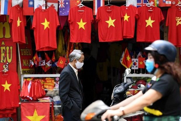 国际媒体:越南战胜疫情的一周 hinh anh 1
