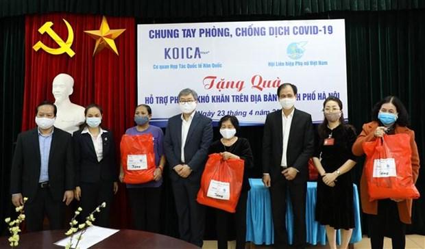 韩国国际合作机构向越南妇女联合会捐赠防疫物资 hinh anh 1