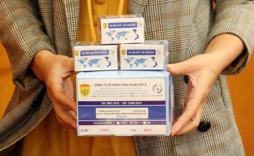 越南研制的新冠病毒检测试剂盒获得世卫组织与英国的认证 hinh anh 1