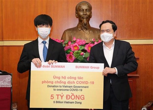 新华集团向越南捐赠50亿越盾 hinh anh 1