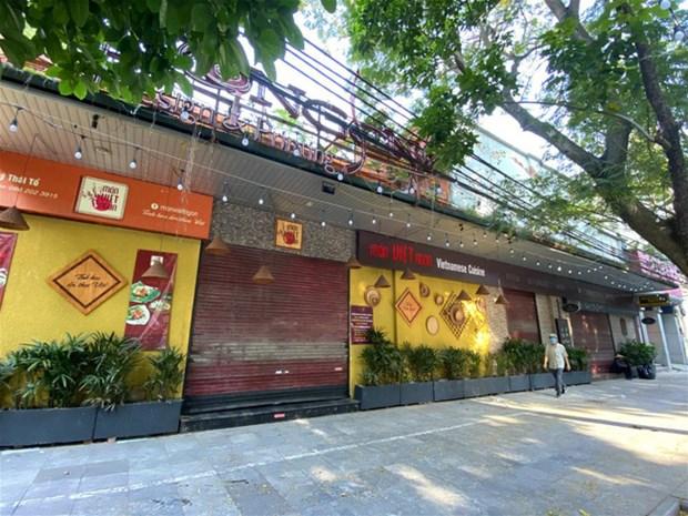 自5月4日起河内市非经营生活必须品商店每日上午9时后开店 hinh anh 1