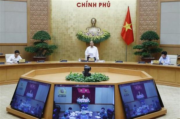 政府总理阮春福:早日恢复和发展经济社会活动 hinh anh 1