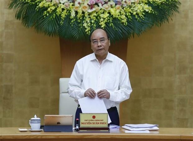 政府总理阮春福:早日恢复和发展经济社会活动 hinh anh 2