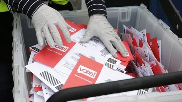 印尼因受疫情影响正式将地区选举时间推迟至12月举行 hinh anh 1