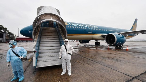 越南交通运输部要求对国际航班上机组人员进行隔离医学观察 hinh anh 1