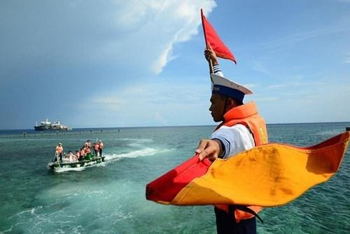 遵守国际法,坚决、坚持捍卫东海主权 hinh anh 1