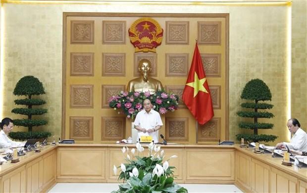 政府总理与企业对话会:越南企业和越南经济朝着积极方向发展 hinh anh 1