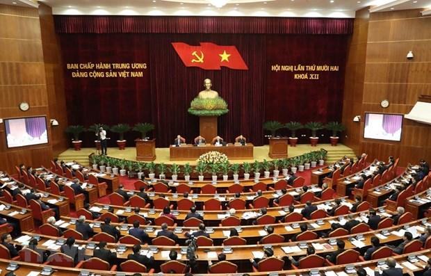 越共十二届中央委员会第十二次全体会议公报(第三号) hinh anh 1