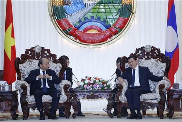 越南政府总理阮春福出席原老挝政府总理西沙瓦·乔本潘大将的国葬仪式 hinh anh 2