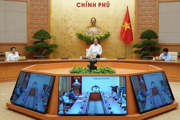 越南政府2020年4月份例行会议决议:全力推进生产经营活动和开展疫情防控工作的双重目标 hinh anh 1