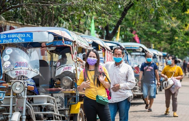老挝准许外国劳动人员入境 马来西亚放宽防疫禁令 hinh anh 1