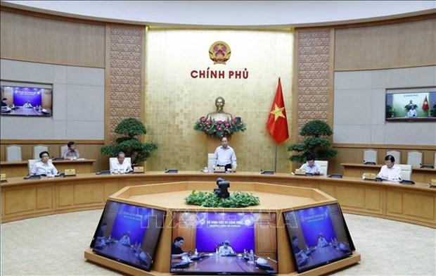 越南政府总理阮春福:疫情传入境内的风险会一直存在 hinh anh 1
