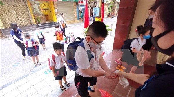 CNN:越南人的生活慢慢地恢复了日常节奏 hinh anh 1