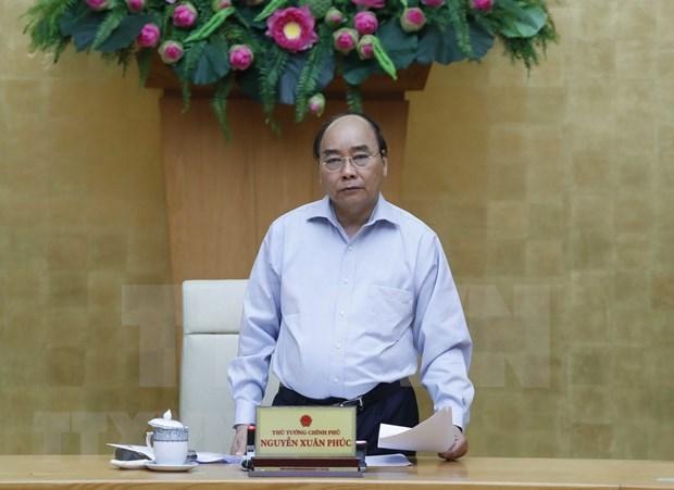 越南政府总理在政府常务委员会新冠肺炎疫情防控工作会议上的发表意见 hinh anh 1