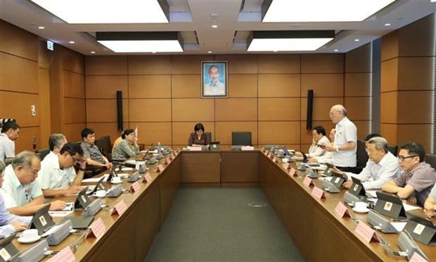 越南第十四届国会第九次会议:保护越南劳动者出国工作的权益 hinh anh 1