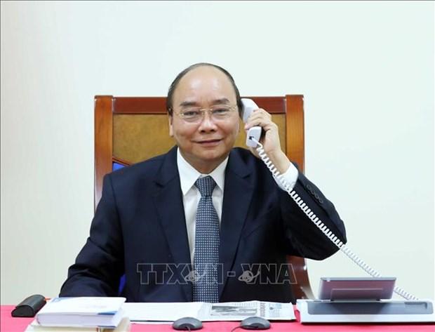 政府总理阮春福与埃克森美孚公司领导通电话 hinh anh 1