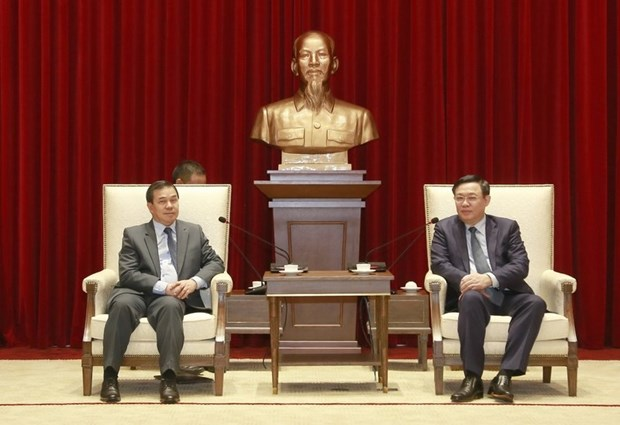 河内全力巩固越南与老挝特殊友好关系 hinh anh 1